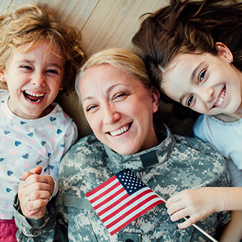 Servicewoman mom with her two happy daughters