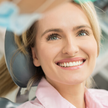 smiling woman talking with her dentist