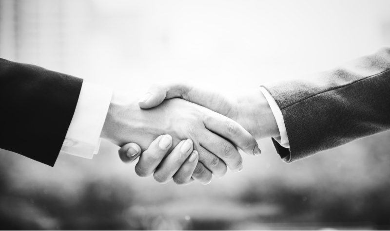 shaking hands showing trust in one dental practice